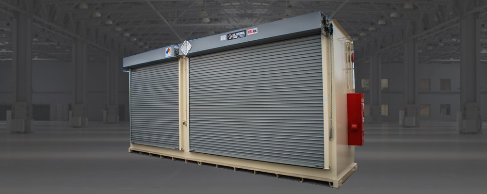Fire Suppression Storage Building with dual roll-up garage doors and fire extinguisher