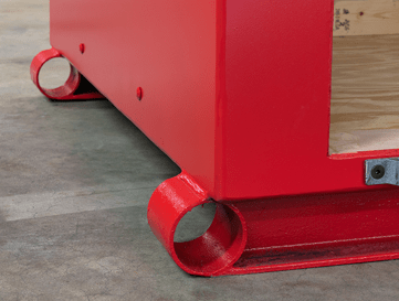 Close up of a bright red explosive storage magazine showing a lift channel for forklift accessibility