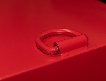 Close up of a bright red explosive storage magazine showing a lift semicircle ring
