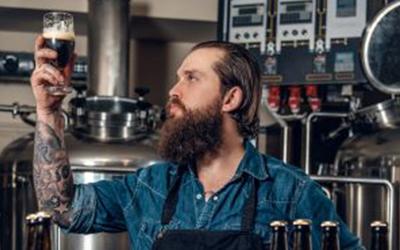 Bartender holding up drink