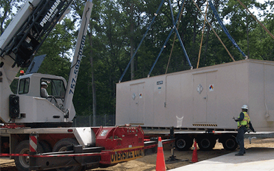 A modular chemical storage building from U.S. Chemical Storage is unloaded.