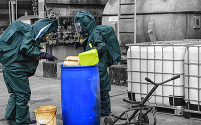 two men practice safe hazardous material storage