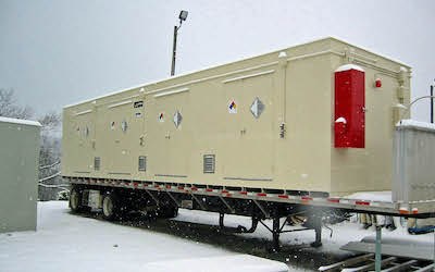 Chemical storage building on flatbed truck in snow
